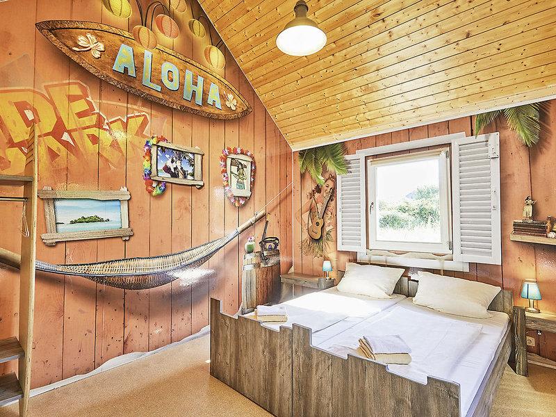 Holiday Camp bietet Übernachtungsmöglichkeiten in bunten Holzhütten